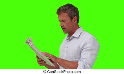 Casual man in shirt reading a newspaper