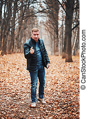 Casual man in the autumn park
