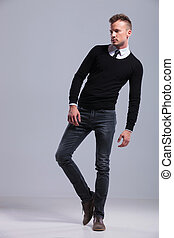 casual man leans on one leg