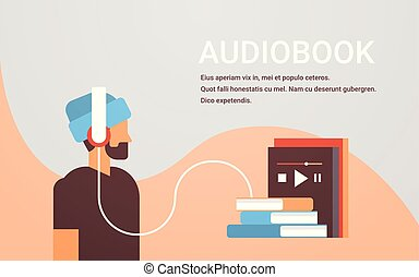 casual man listening audiobook through headphones bearded...