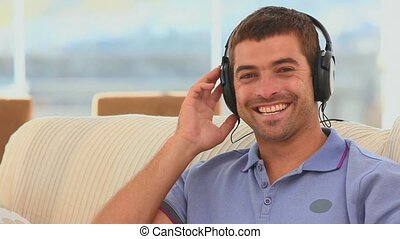 Casual man listening to music