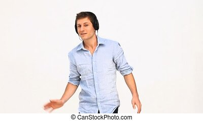 Casual man listening to music with headphones