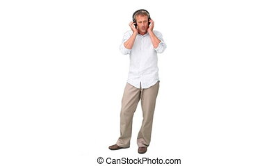 Casual man listenning to music
