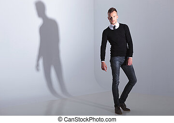 casual man looking into the camera
