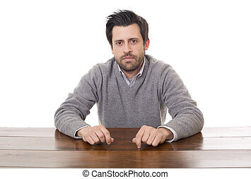 casual man on a desk