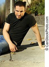 Casual man on sidewalk