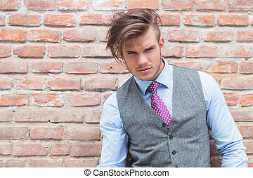 casual man outdoor with messed up hair - casual young man...