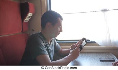 Casual man reading from mobile phone screen while reads sms...