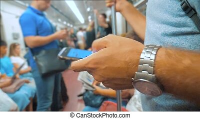Casual man reading from mobile phone smartphone screen while...