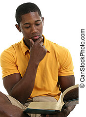 Casual Man Reading - Attractive young man reading book....