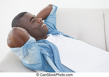 Casual man relaxing on his sofa