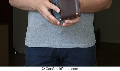 Casual Man Removes Wallet With No Money - Man shows that he...