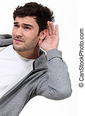 Casual man struggling to hear