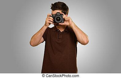 Casual Man Taking Photo