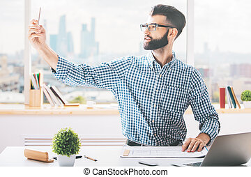 Casual man using cellphone