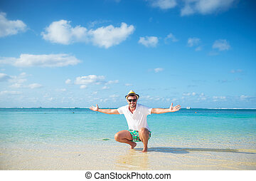 casual man welcoming you to the beach of mauritius