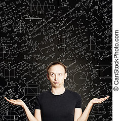 Casual man with empty open hands on blackboard science background. Education, student exam and brainstorm concept