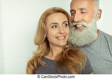 casual middle aged couple in love smiling isolated on white