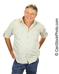 Casual middle aged man standing and smiling.