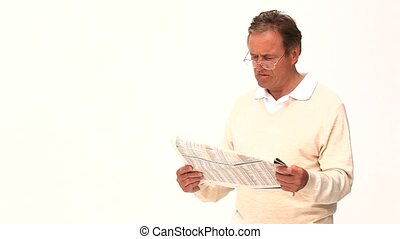 Casual middle aged man reading a newspaper