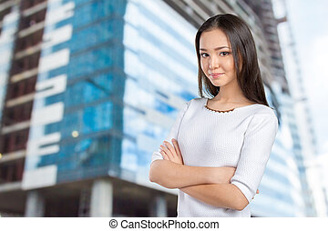 Casual mixed-race Asian Caucasian woman smiling looking happy