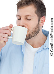 Casual model drinking a coffee