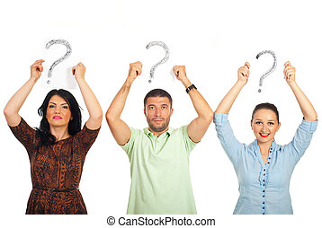 Casual people holding questions mark overhead - Three casual...