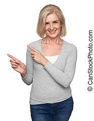 casual smiling old woman pointing finger. Isolated - ...