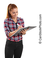 Casual smiling woman writing in a notebook