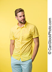 Casual style. Man on calm face posing confidently put hands pockets. Man attractive in casual shirt. Guy fashion model wear casual shirt. Feel comfortable in simple outfit. Casual comfortable outfit
