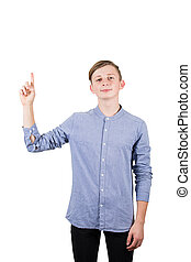 Casual teen boy pointing his index finger up isolated over white background.