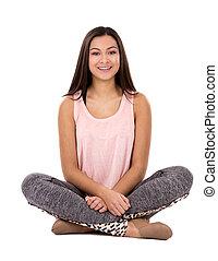casual brunette teen girl posing on white background