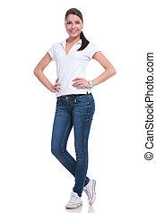 casual woman hands on hips - full length picture of a casual...