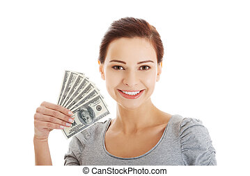 Casual woman holding money. - Casual woman holding money -...