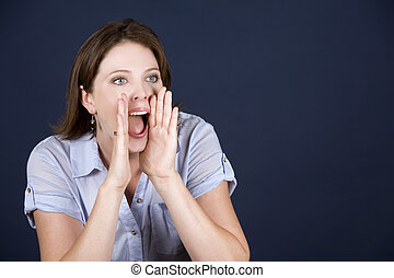 casual woman in blue - pretty casual brunette screaming on...
