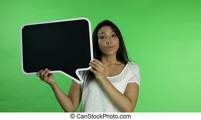 Casual woman isolated green screen worried with blank sign