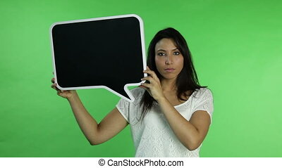 Casual woman isolated green screen upset with blank sign
