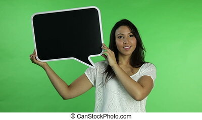 Casual woman isolated green screen confident with blank sign