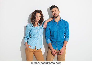 casual woman leaning on her man's shoulder
