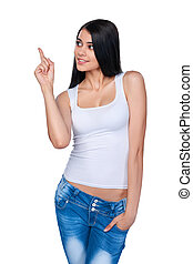 Casual woman pointing at white background
