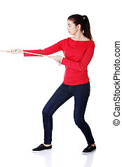 Casual woman pulling a rope