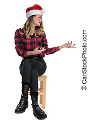 casual woman sitting and presenting to a side
