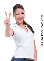 casual woman victory sign - casual young woman showing the...