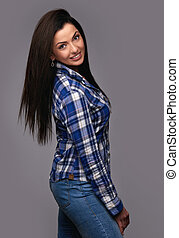 casual woman wearing jeans and shirt isolated