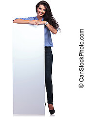 casual woman with a blank board - full length picture of a ...