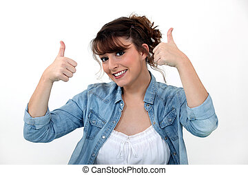 Casual woman with both thumbs up.