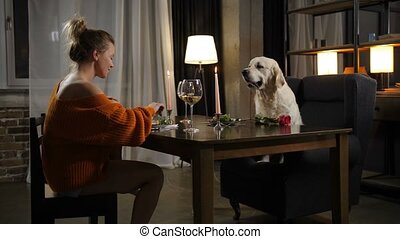 Casual woman with dog during romantic dinner - Attractive...