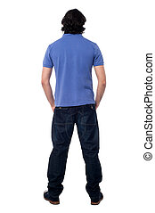 Casual young man facing the wall - Rear view of a casual...