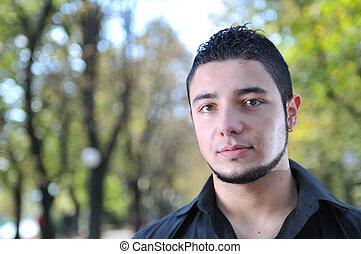 casual young man outdoor posing