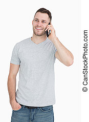 Casual young man using mobile phone over white background